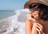Woman in straw hat sea portrait