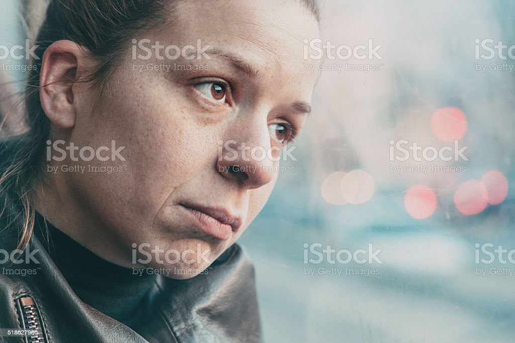 Woman in streetcar alone and depressed stock photo