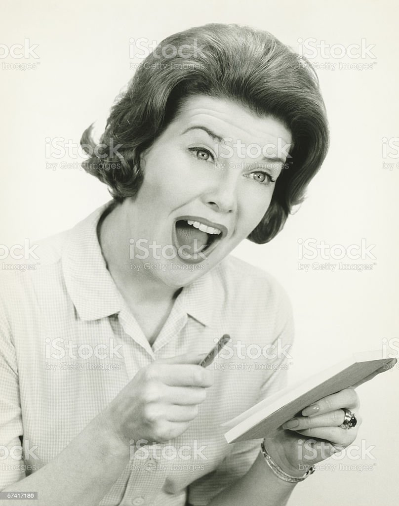 Woman in striped blouse with surprised facial expression, posing in studio, (B&W), (Portrait) stock photo
