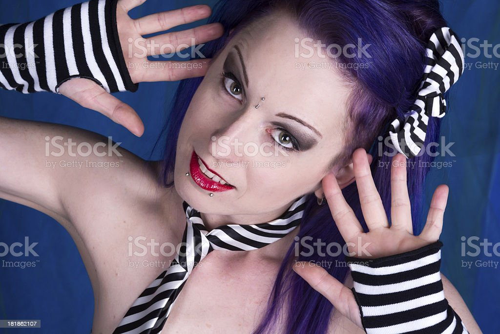 Woman in stripes with hands by face. stock photo