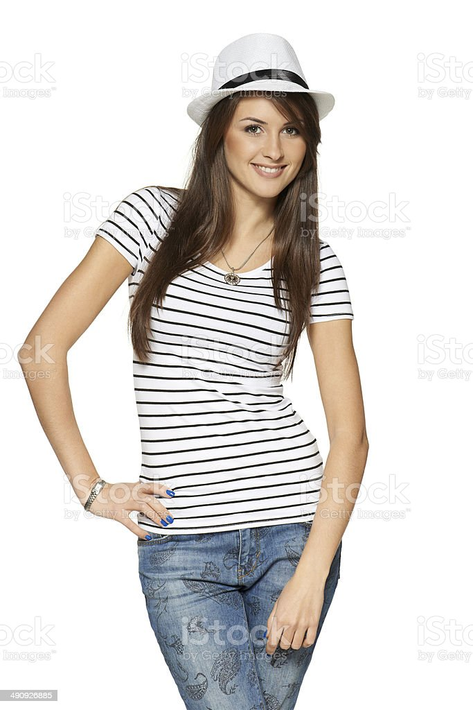 Woman in stripped t-shirt and white straw hat stock photo