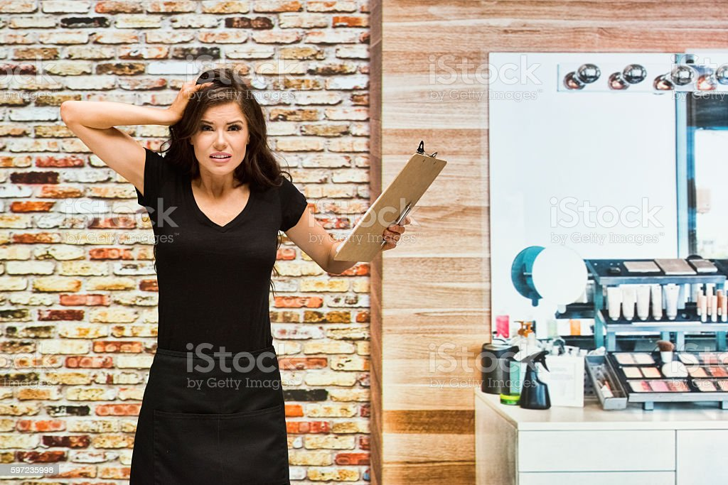 Woman in studio and looking sad stock photo