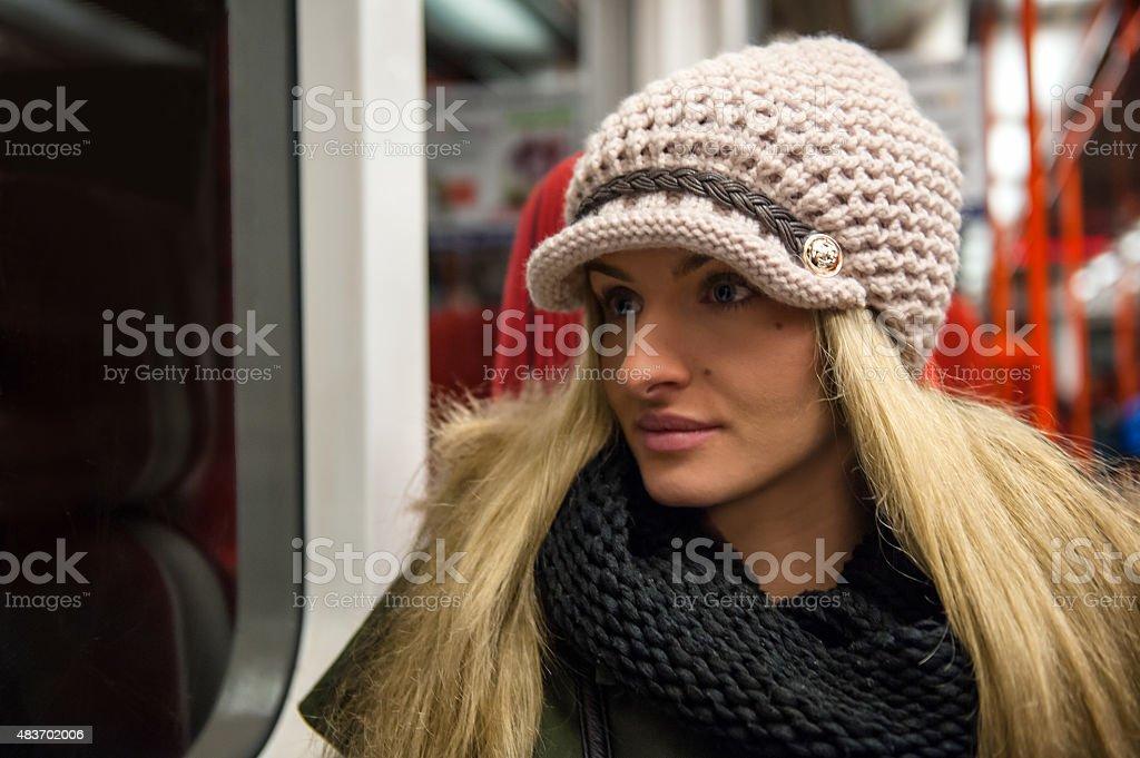 Woman in subway train stock photo