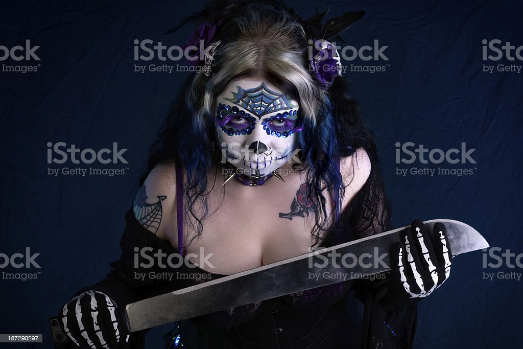 Woman in sugarskull makeup leaning forward menacingly. royalty-free stock photo