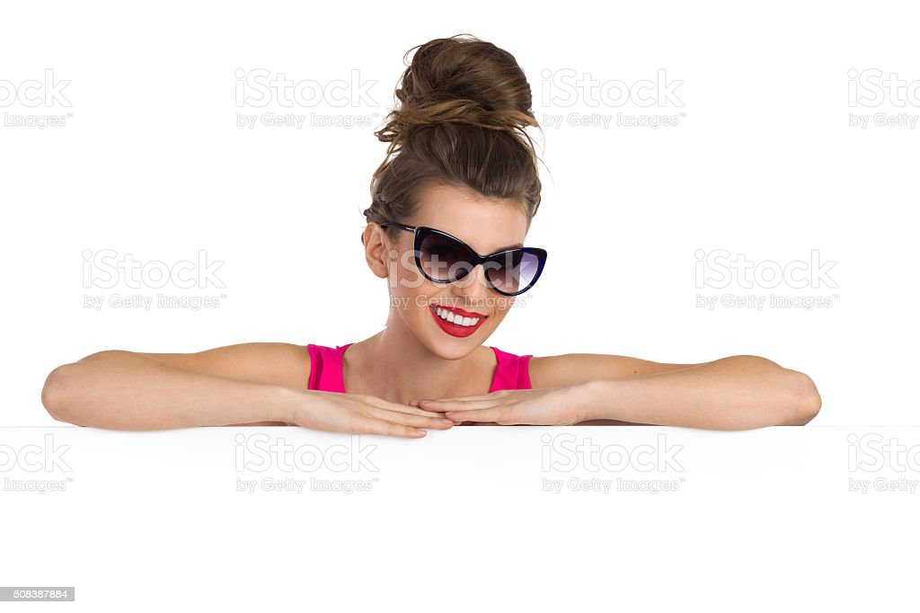 Woman In Sunglasses Bassed At A Banner stock photo