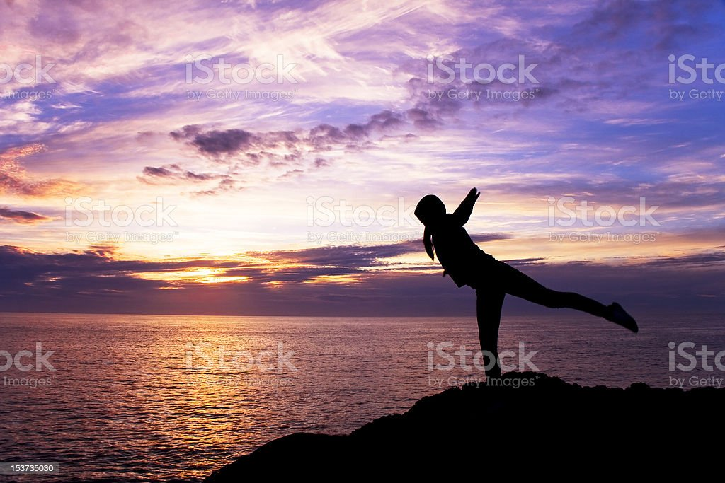 Woman in sunset stock photo