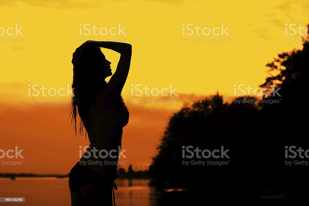 Woman in sunset royalty-free stock photo