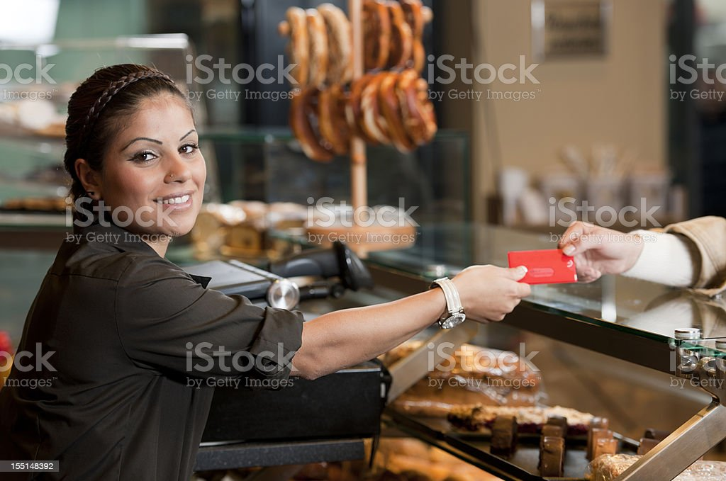 Woman in supermarket paying with credt card royalty-free stock photo