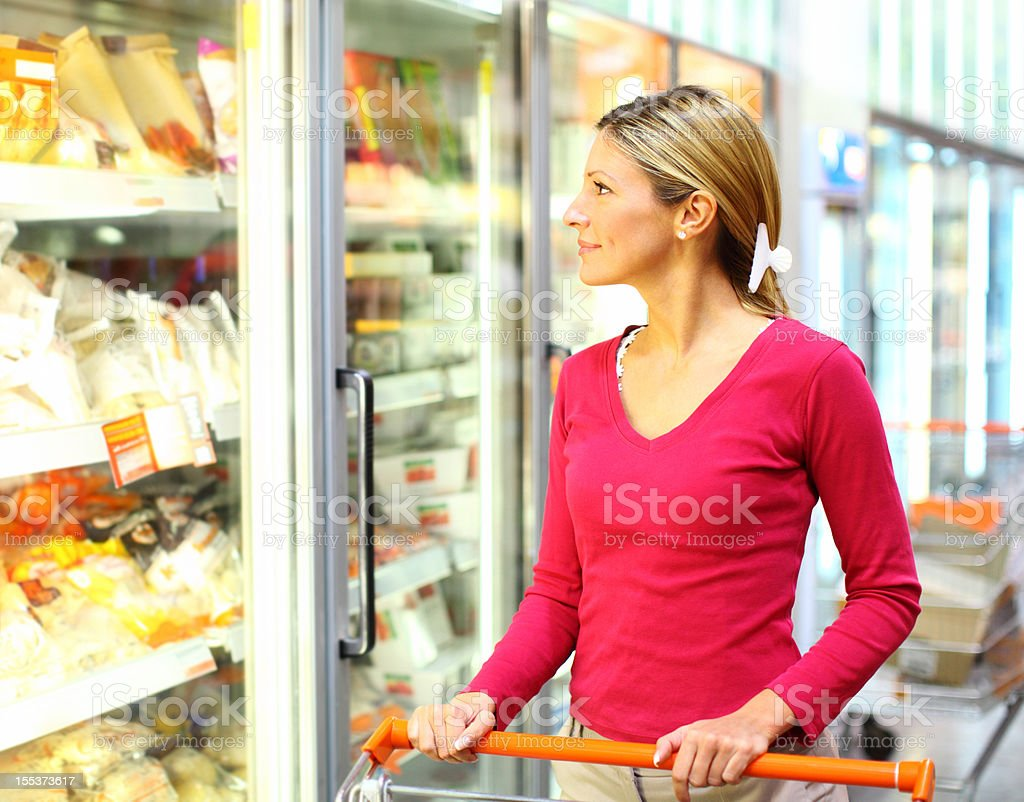 Woman in supermarket. stock photo