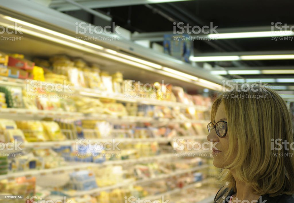 Woman in Supermarket royalty-free stock photo