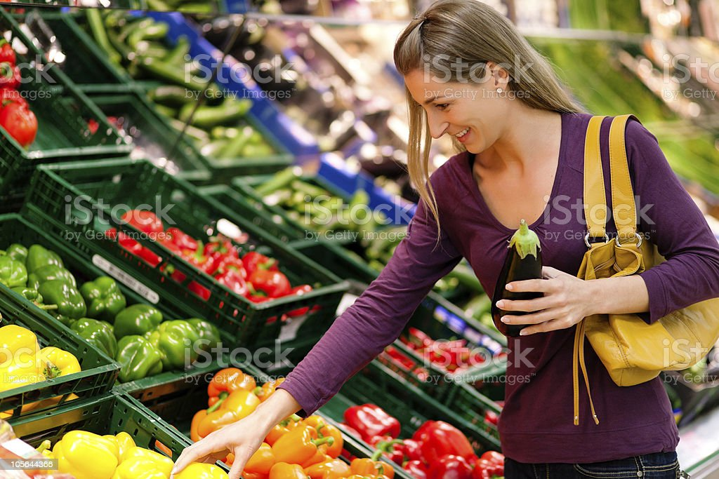 Woman in supermarket shopping groceries royalty-free stock photo