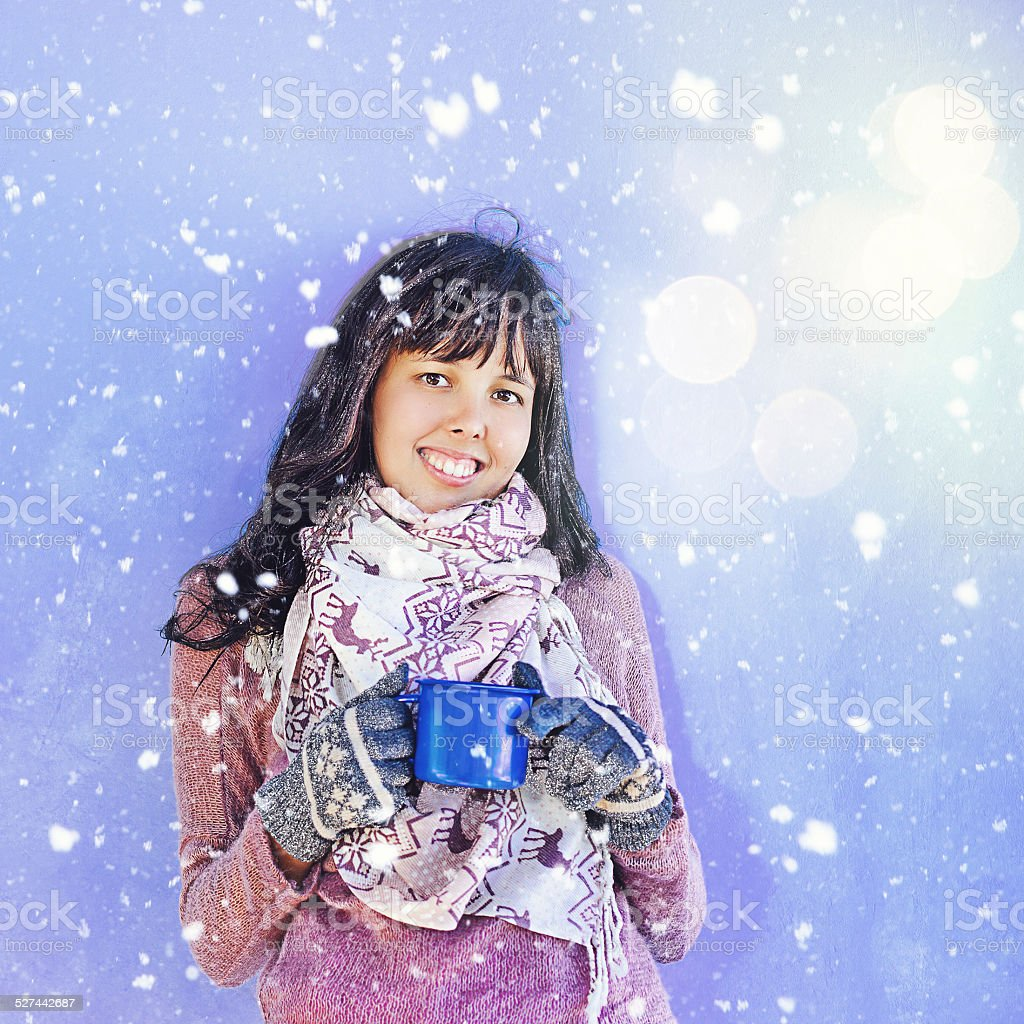 Woman in sweater and gloves with a mug stock photo