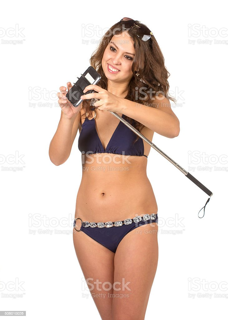 Woman in swimsuits taking a selfie. stock photo