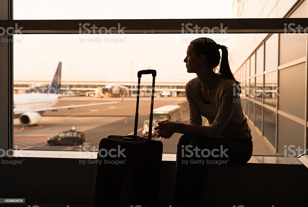 Woman in the airport stock photo