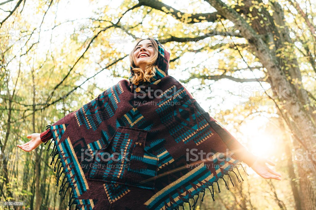 Woman in the  autumn forest stock photo