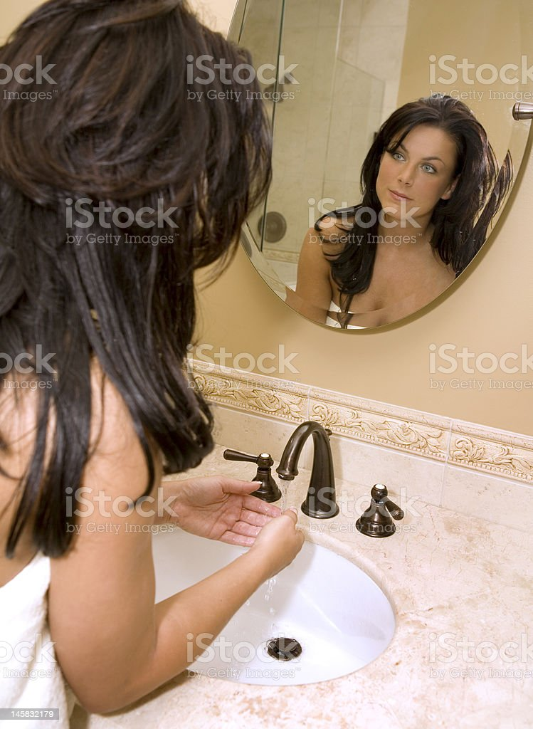 woman in the bathroom royalty-free stock photo