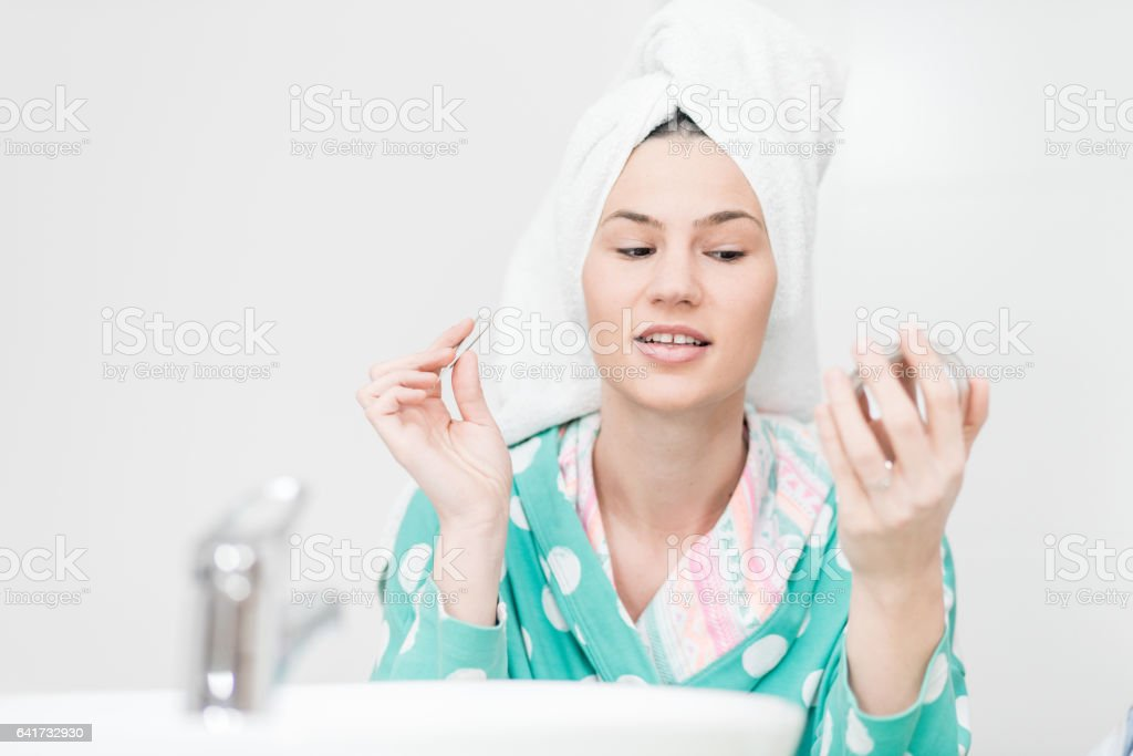 Woman in the bathroom stock photo