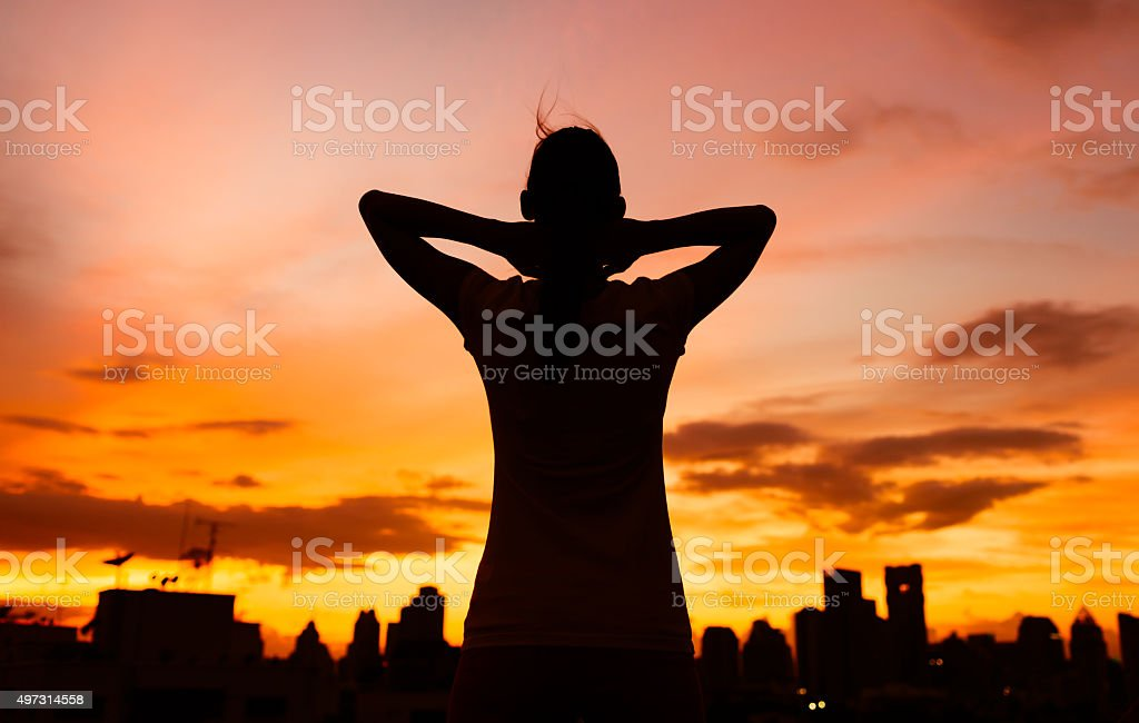Woman in the city taking a moment to relax. stock photo