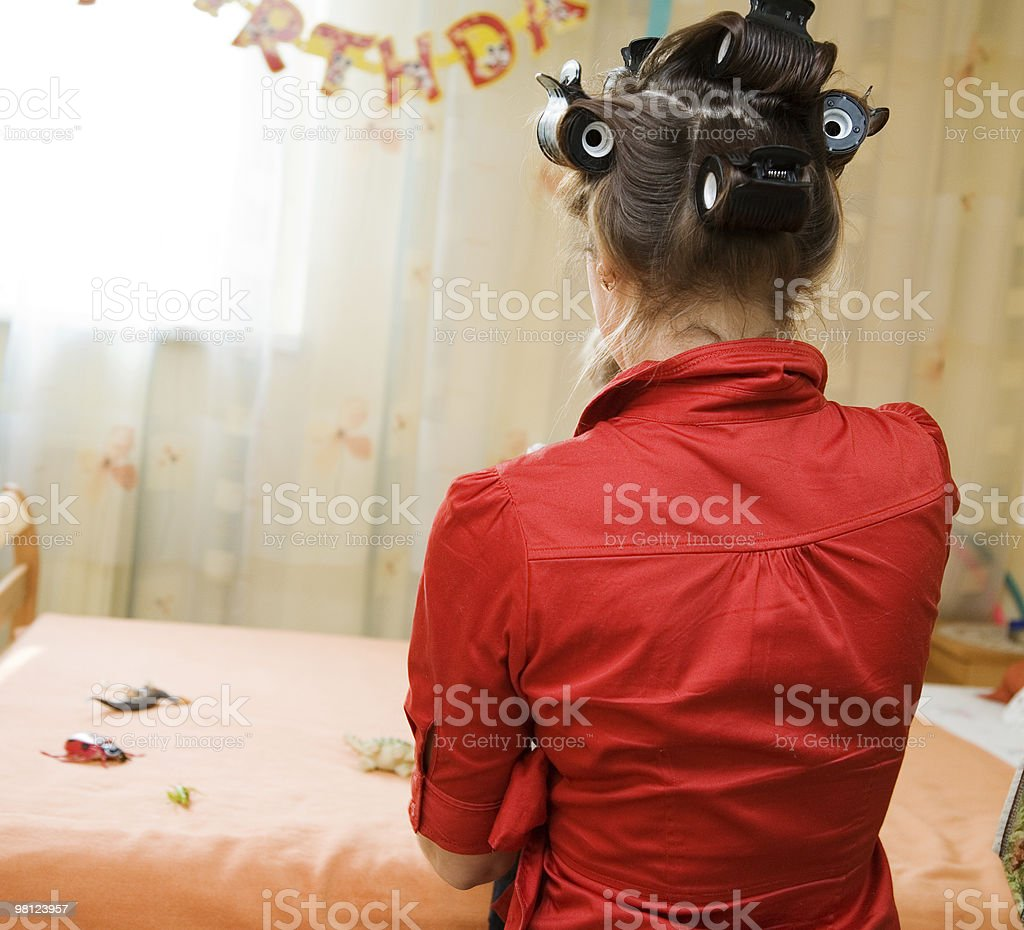 Woman in the curler royalty-free stock photo