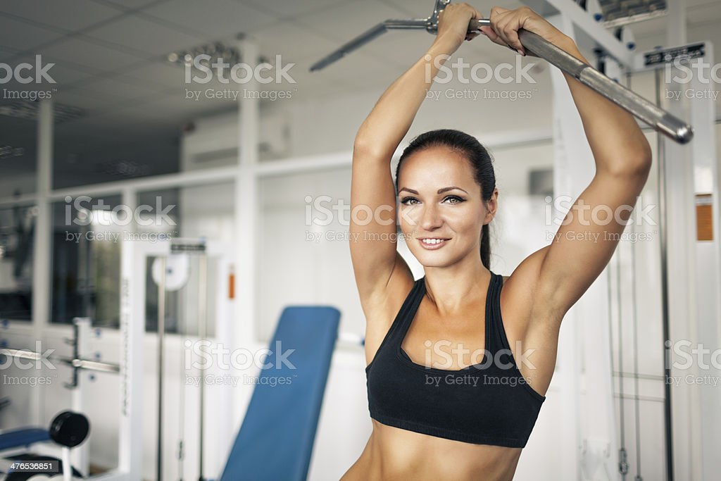 Woman in the fitness club royalty-free stock photo