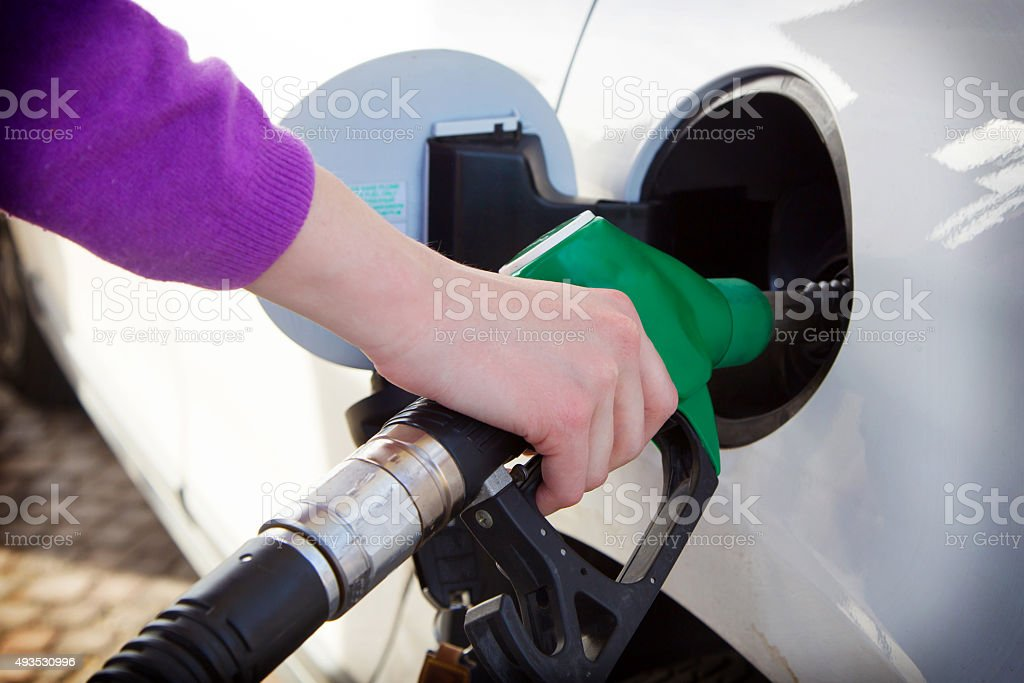 Woman in the gas station stock photo