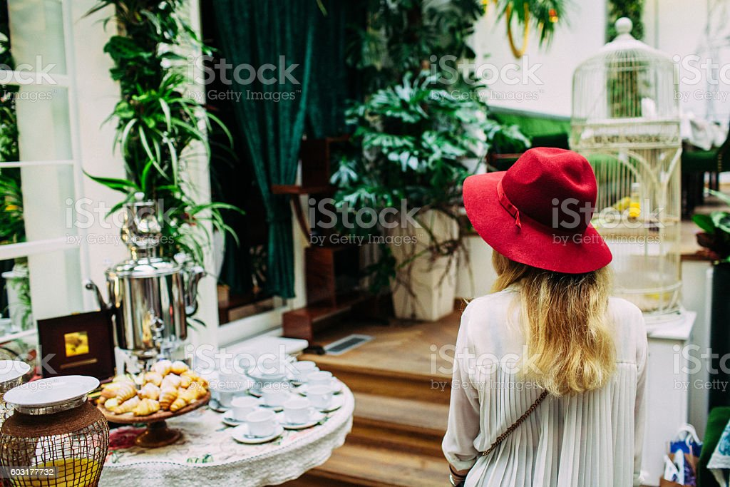 Woman in the hotel buffet stock photo