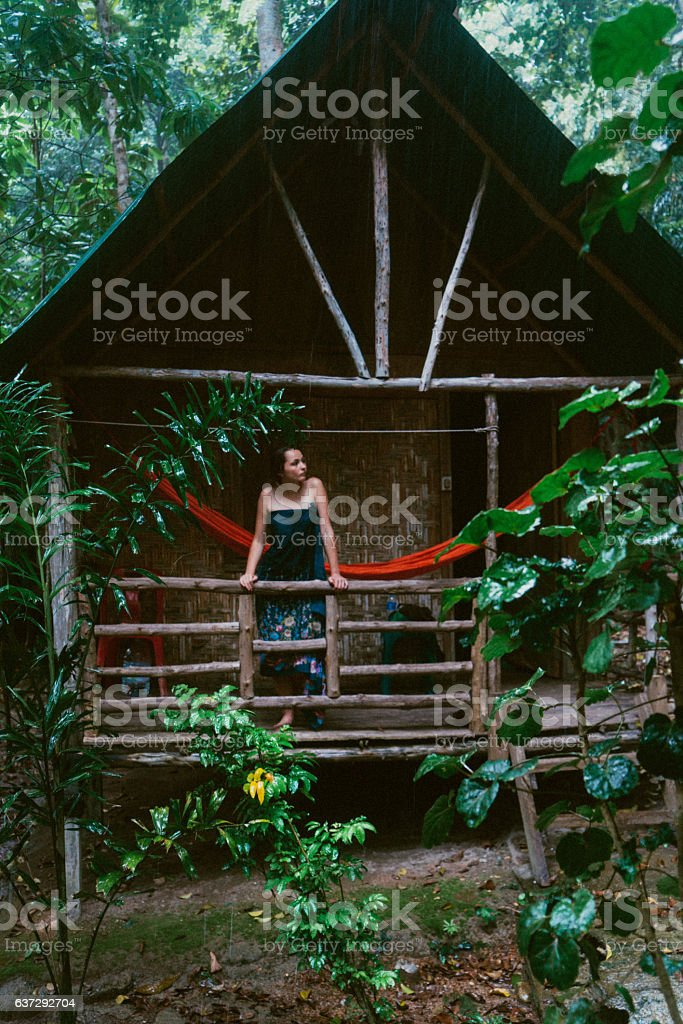 Woman in the hut in the jungles stock photo