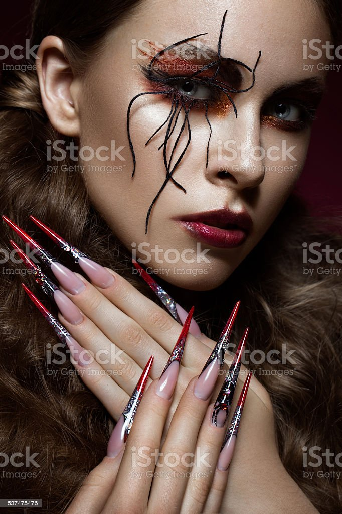 woman in the image of spider with creative art makeup stock photo