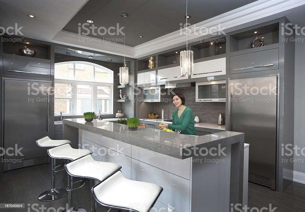 Woman in the kitchen royalty-free stock photo