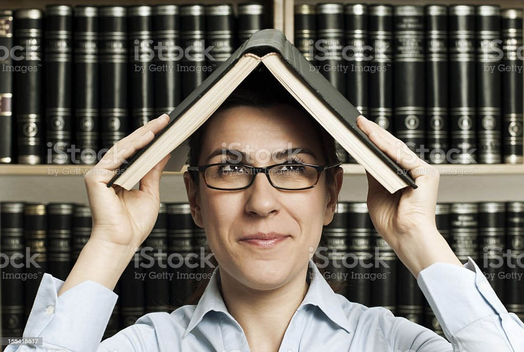 woman in the library royalty-free stock photo