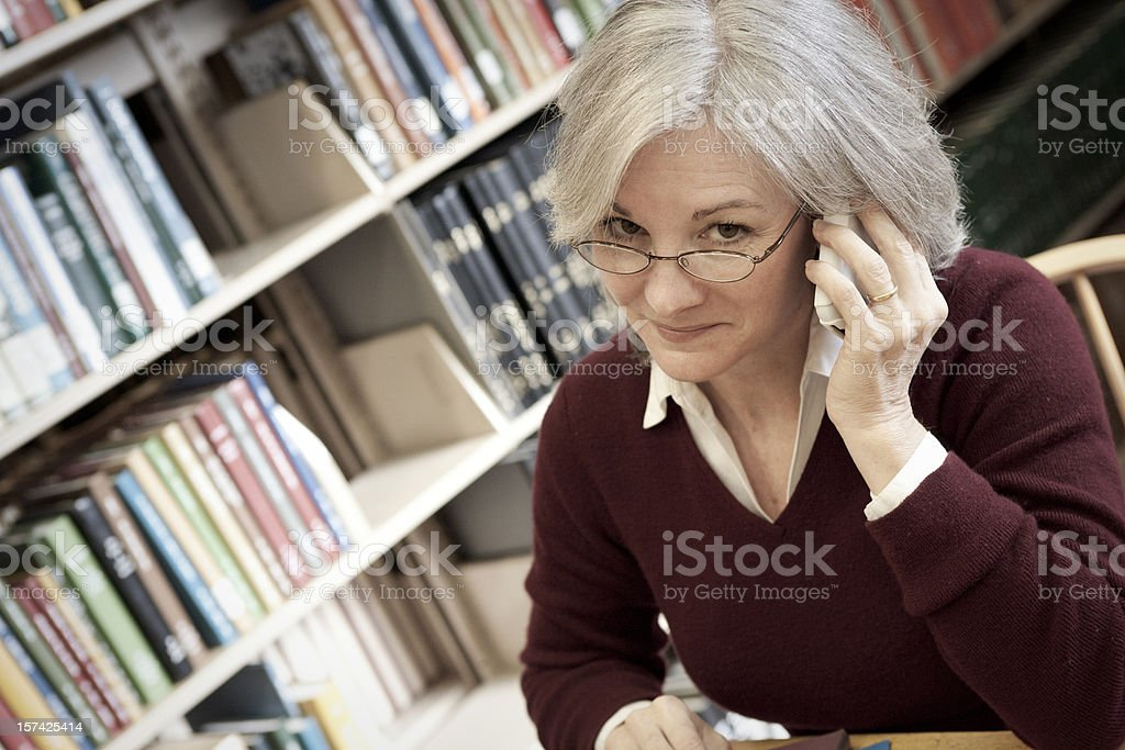 Woman in the Library Series royalty-free stock photo