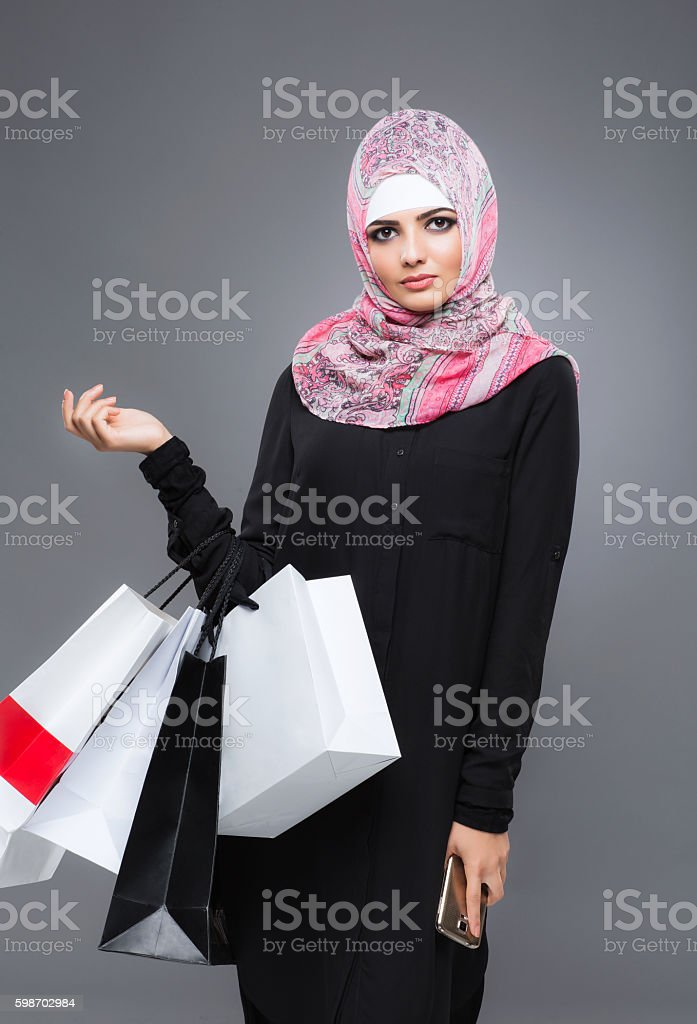 Woman in the Muslim scarf hijab stock photo