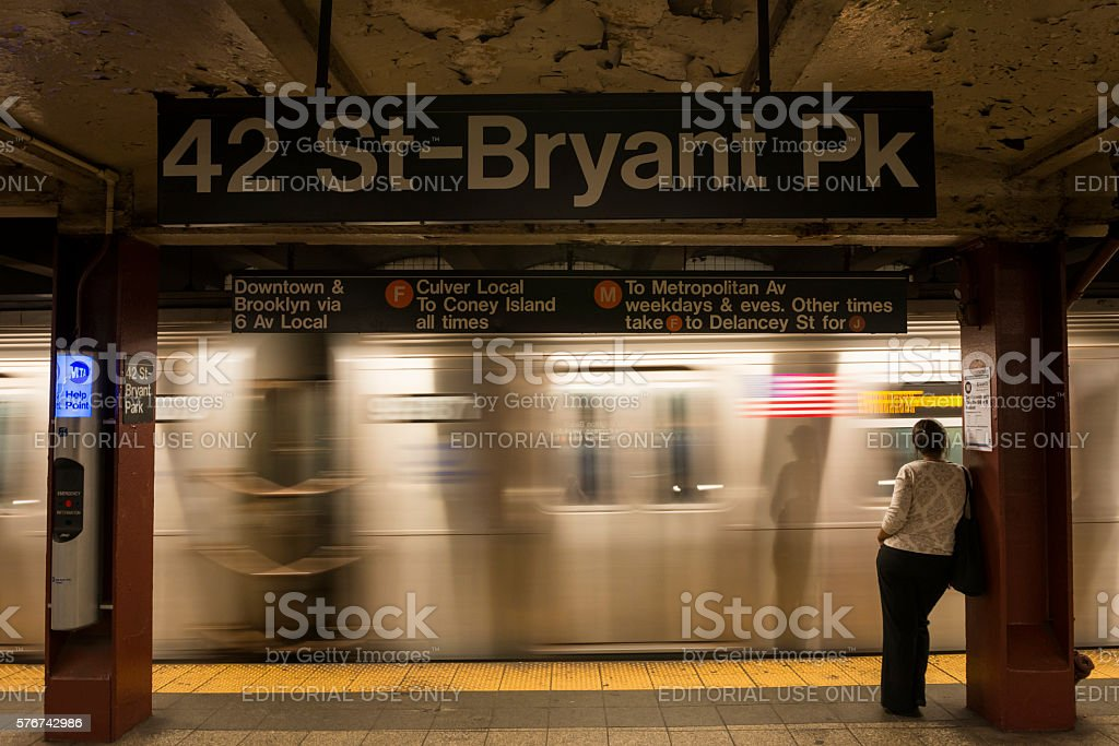 Woman in the New York City subway stock photo
