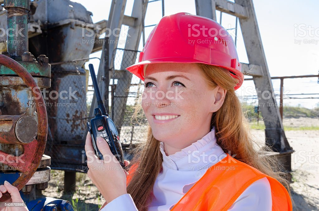 Woman in the oilfield stock photo