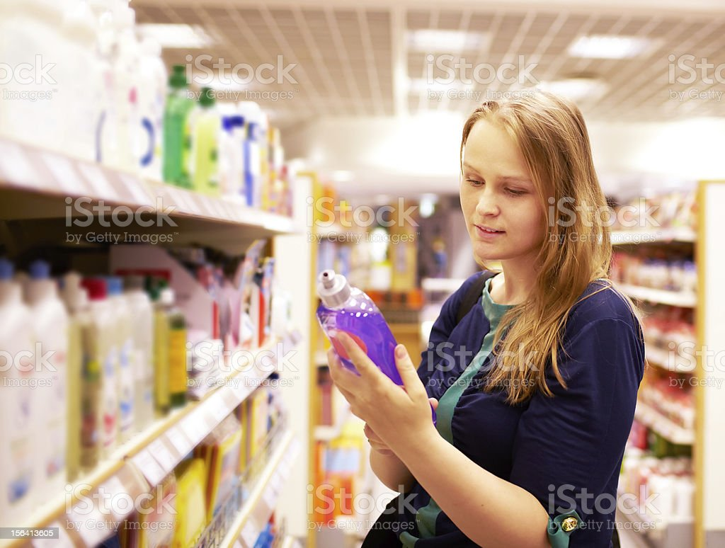 Woman in the supermarket. stock photo