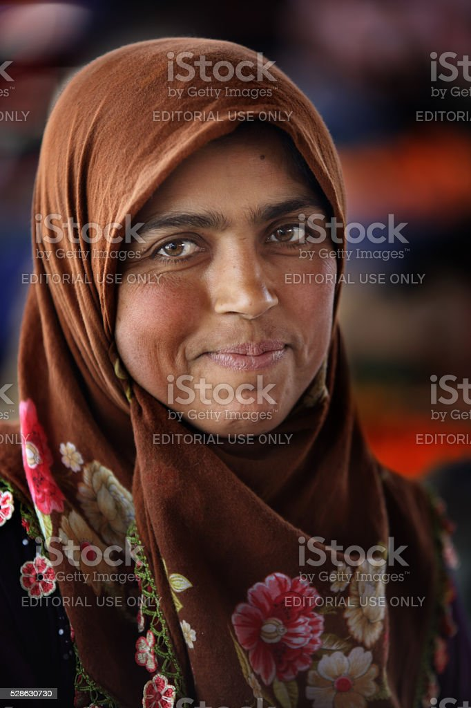 Woman in the Turkish village market stock photo
