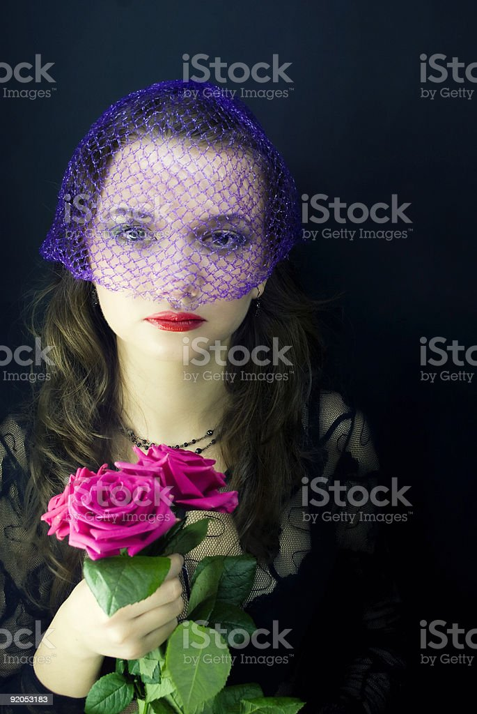 woman in the veil with a bouquet of roses royalty-free stock photo