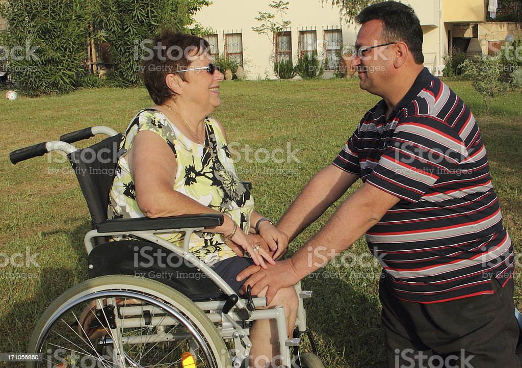 woman in the wheelchair and man stock photo