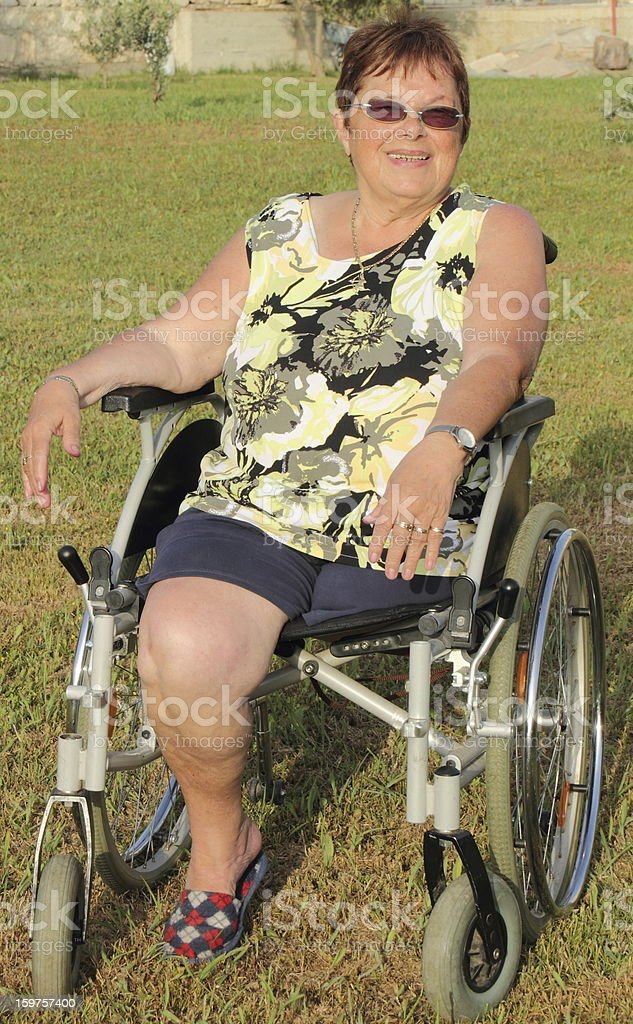 woman in the wheelchair happy smile stock photo