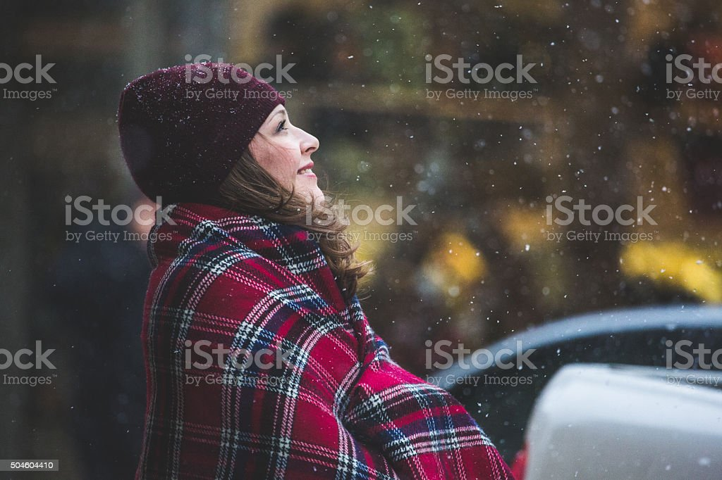 Woman in the winter city stock photo