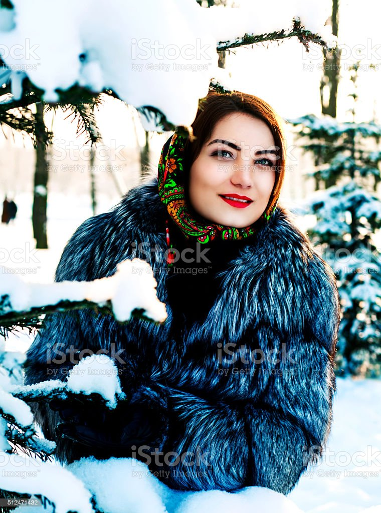 woman in the winter park stock photo