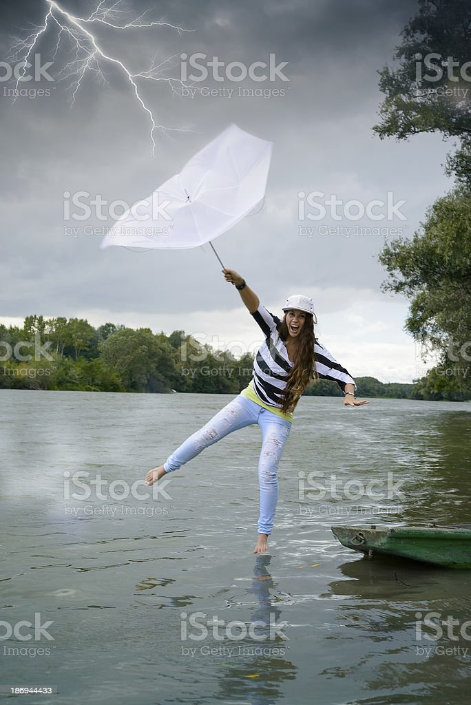 Woman in thunderstorm royalty-free stock photo