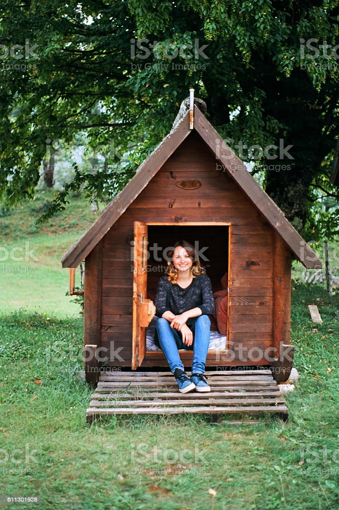 Woman in tiny house stock photo