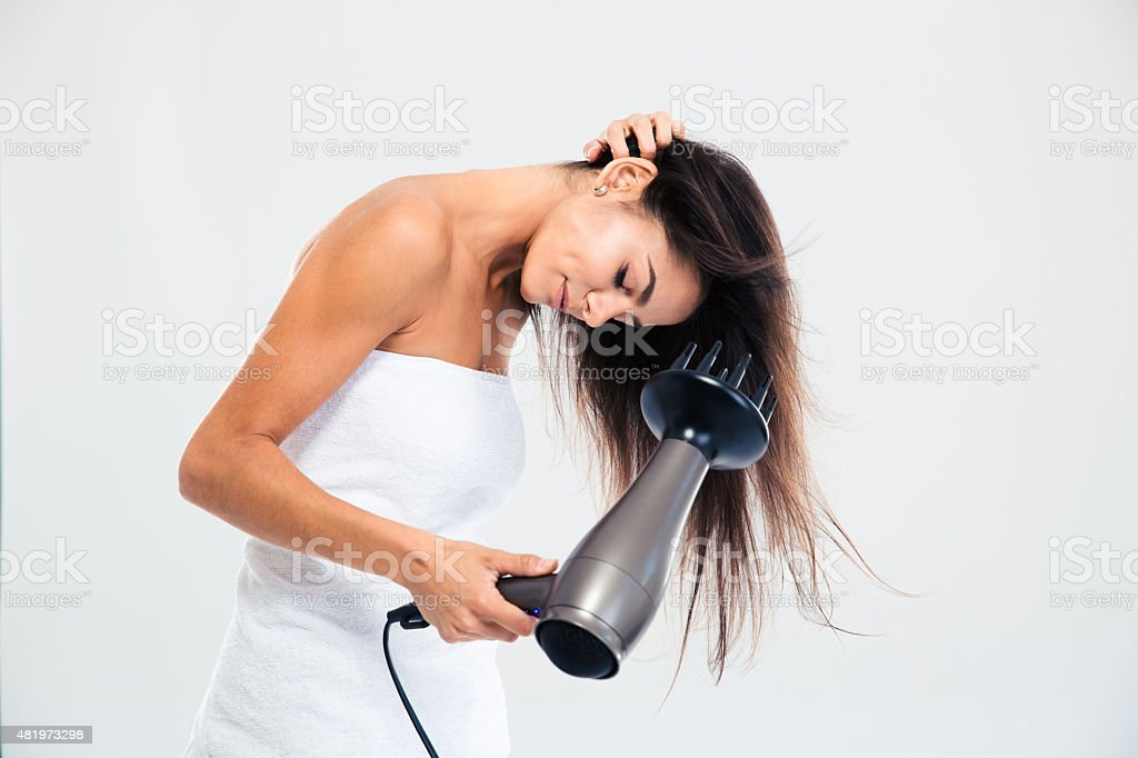 Woman in towel drying her hair stock photo