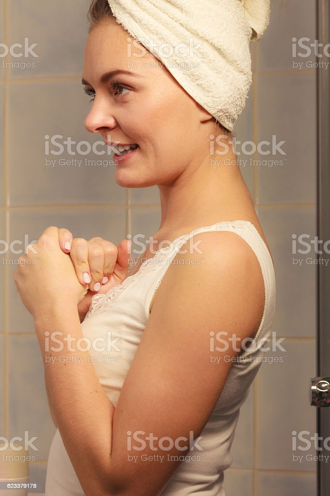 Young woman after morning shower in a bathroom, beautuful female...