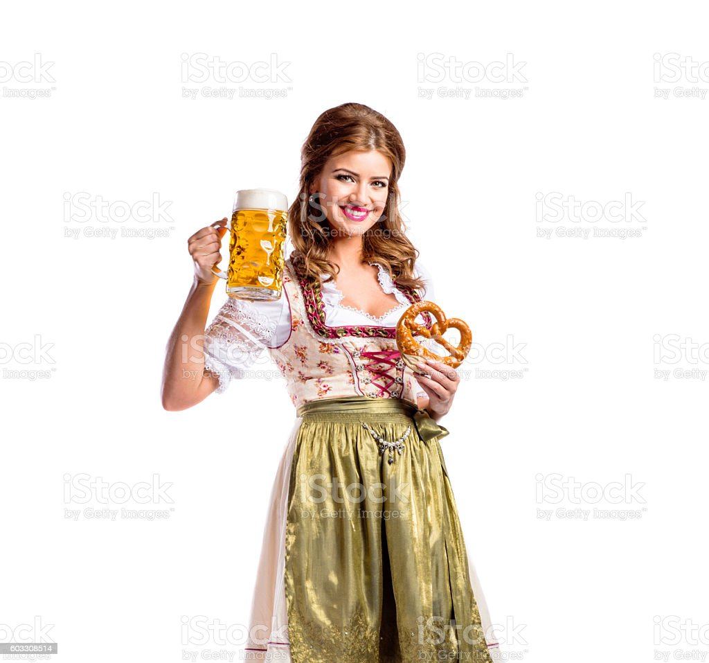 Woman in traditional bavarian dress holding beer and pretzel stock photo