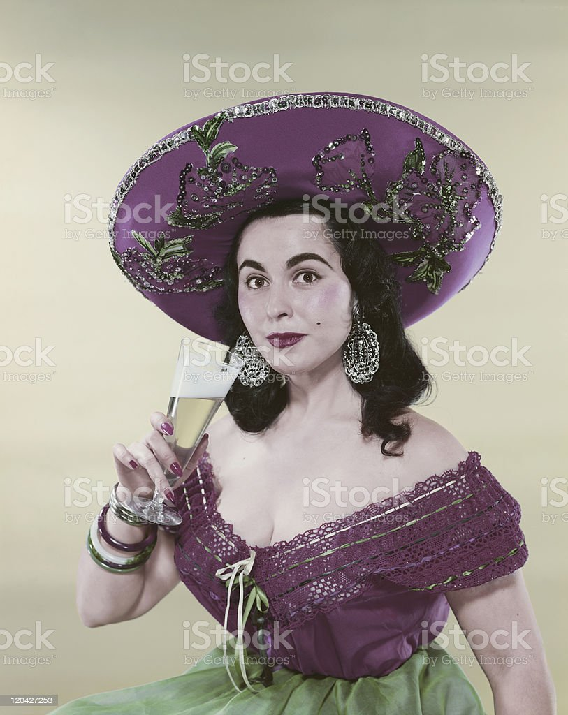 Woman in traditional clothing holding glass of wine, portrait stock photo