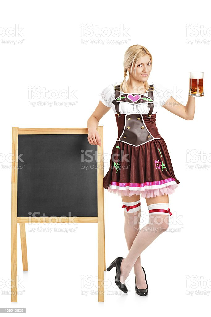Woman in traditional costume holding a beer royalty-free stock photo