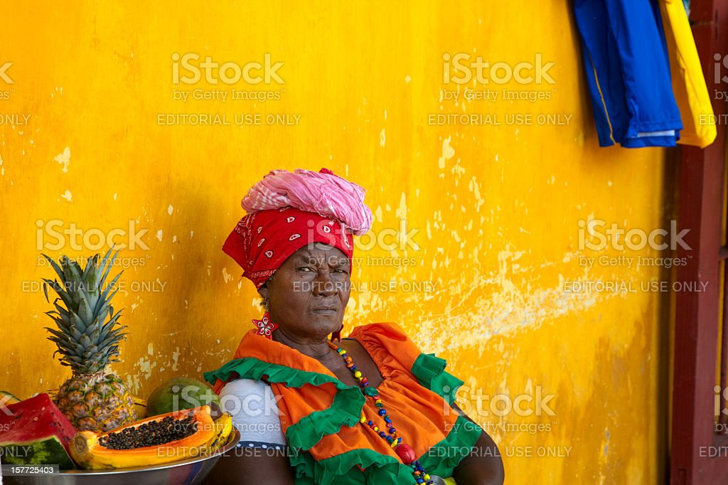 Woman in Traditional Garb, Cartagena, Columbia with Bowl of Fruit royalty-free stock photo