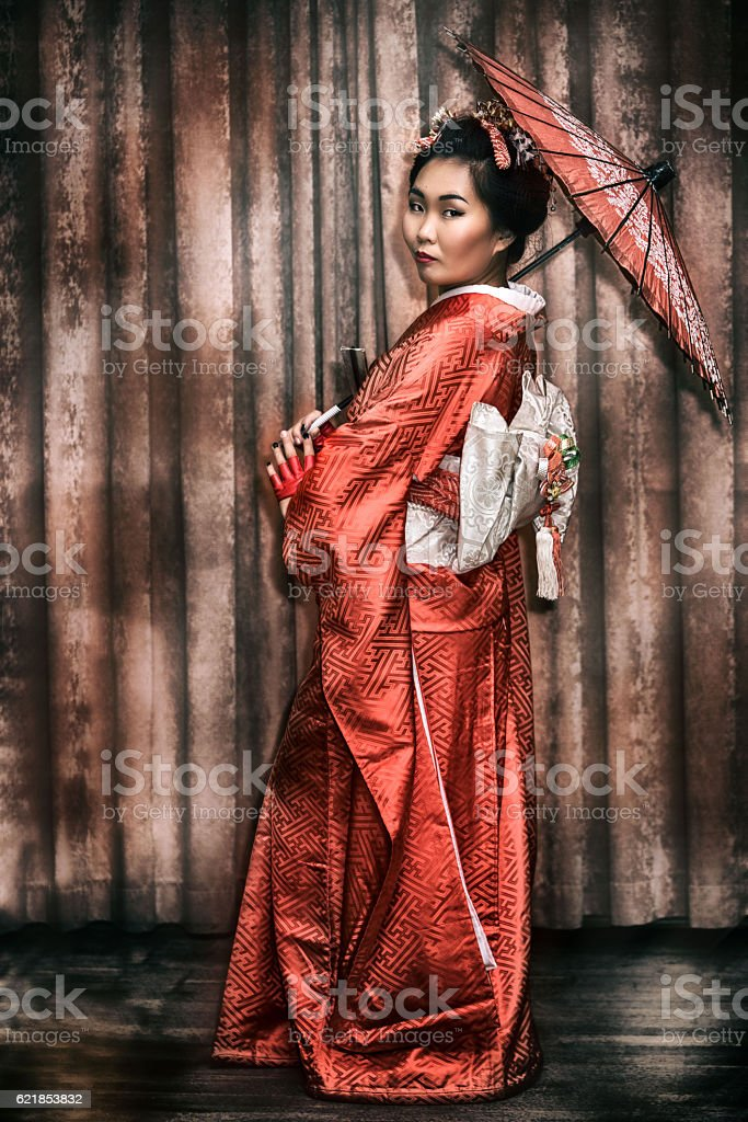 Woman in traditional Japanese kimono with parasol stock photo